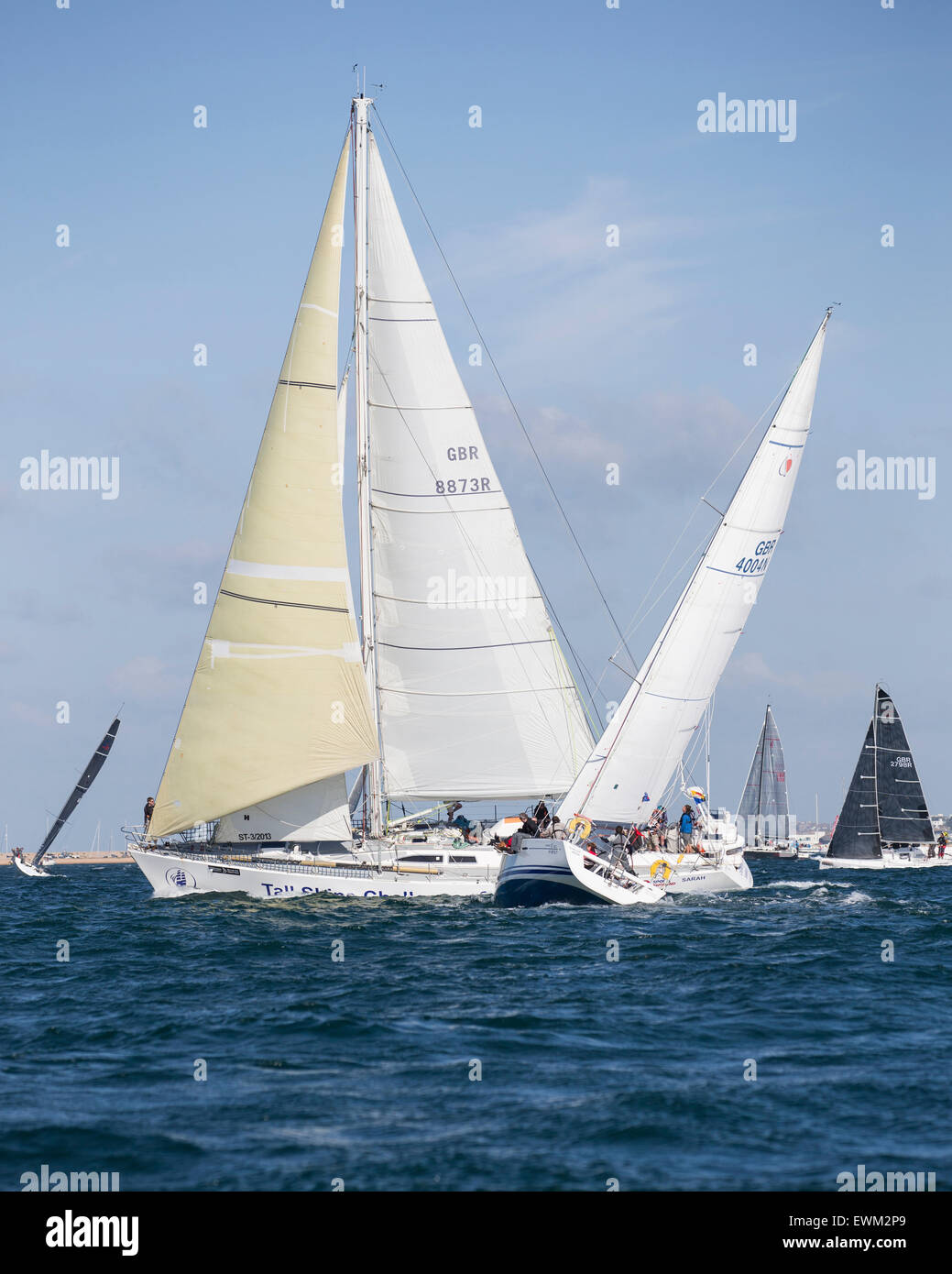 UK. 27th June, 2015. Bavaria 38 'Sarah'  in a close tacking contest during the 2015 Round the Island Race - Stock Image