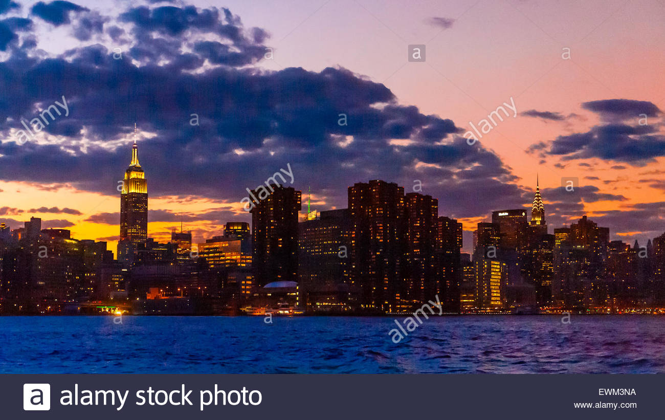 East River at Twilight (Empire State Building on left and Chrysler Building on right), New York, New York USA. - Stock Image