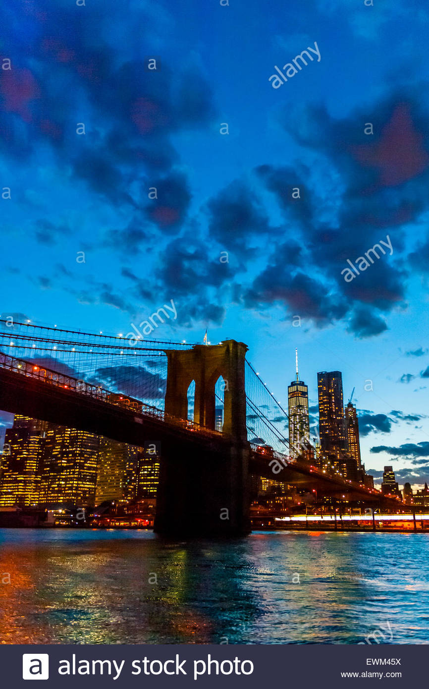 The Brooklyn Bridge and the skyline of Lower Manhattan at twilight from the East River, New York, New York USA. Stock Photo