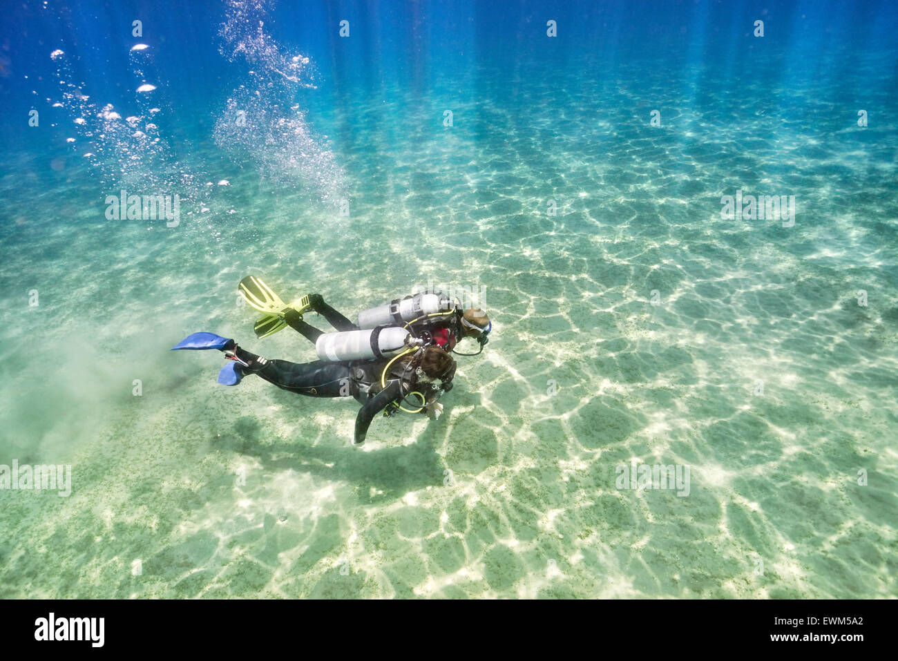 Marsa Alam, dive instructor with novice diver, first underwater dive, Red Sea, Egypt - Stock Image