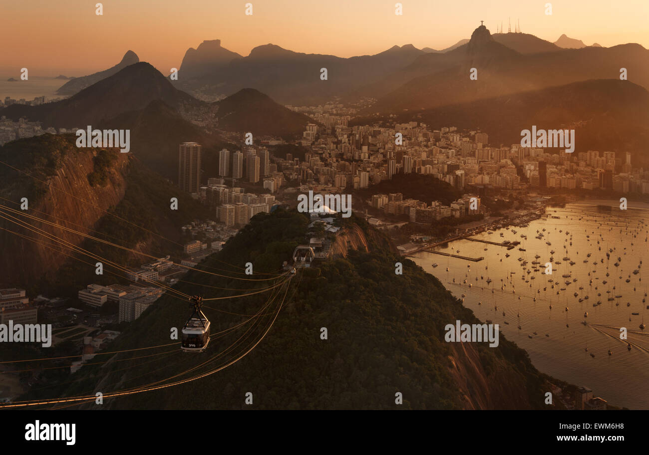 Christ the Redeemer atop Mount Corcovado and the cable car from Sugarloaf (Pao de Acucar) in Rio de Janeiro, Brazil Stock Photo
