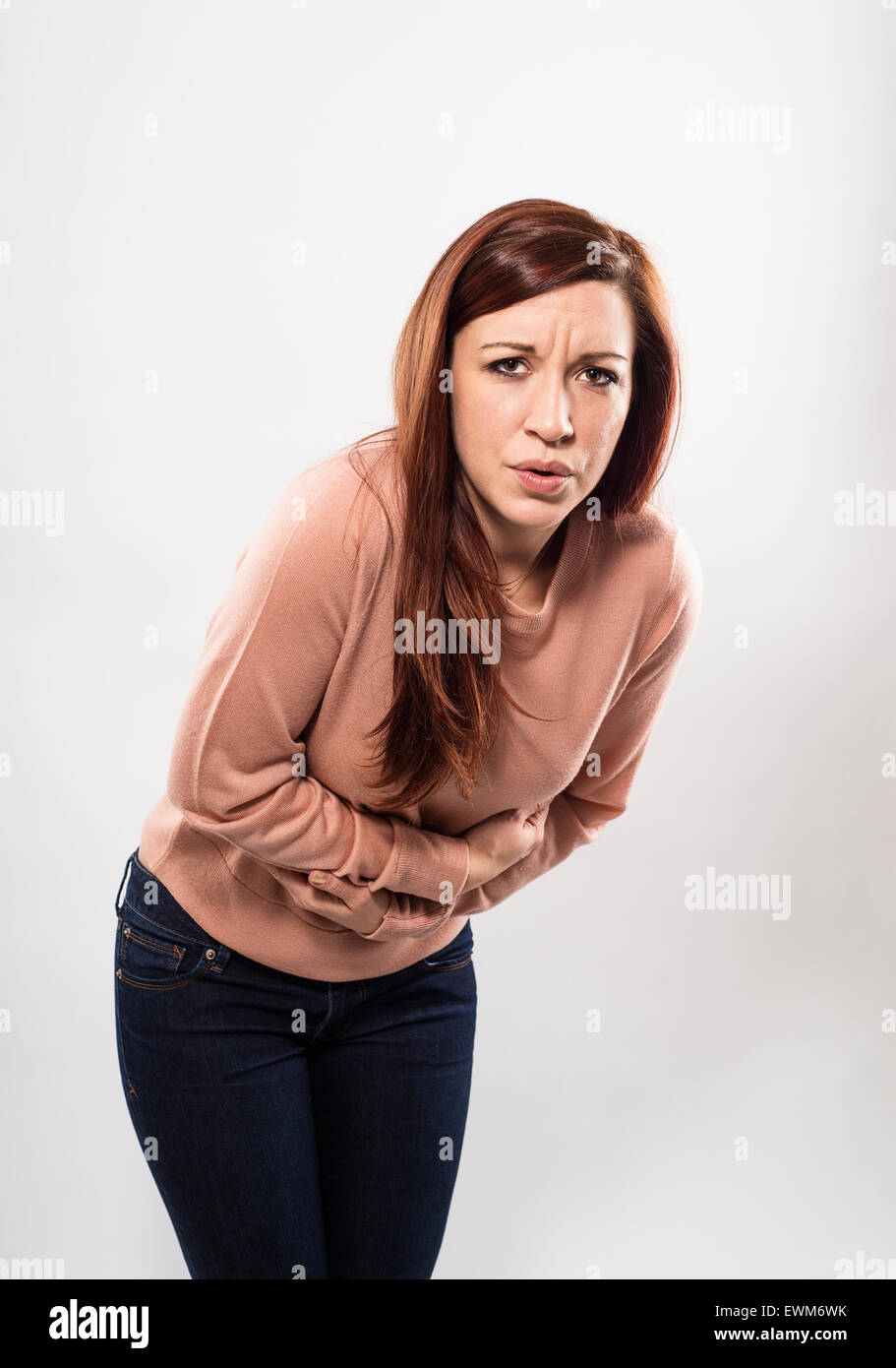 A woman with a stomach ache. - Stock Image