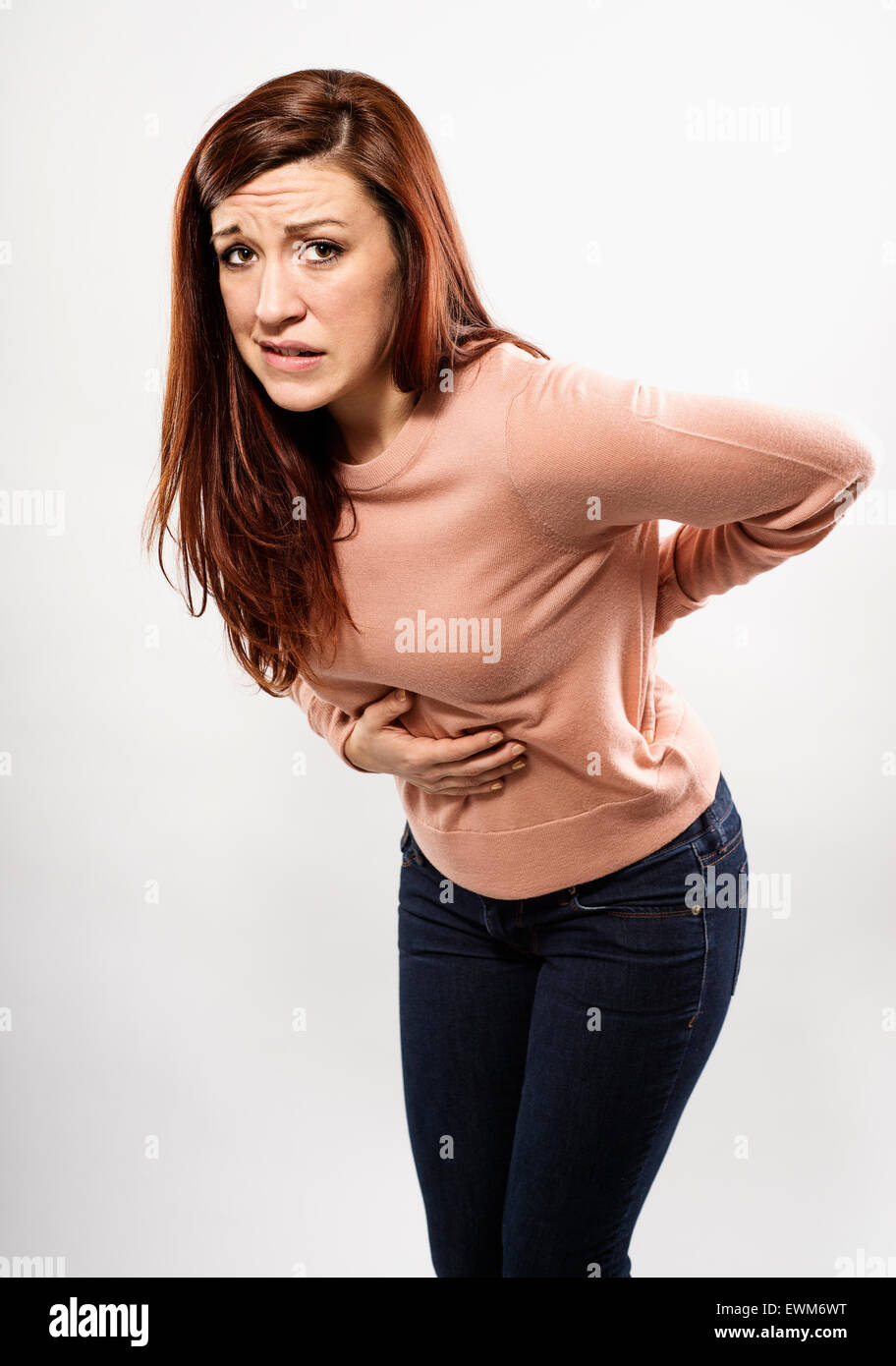 portrait of a woman with a stomach ache - Stock Image