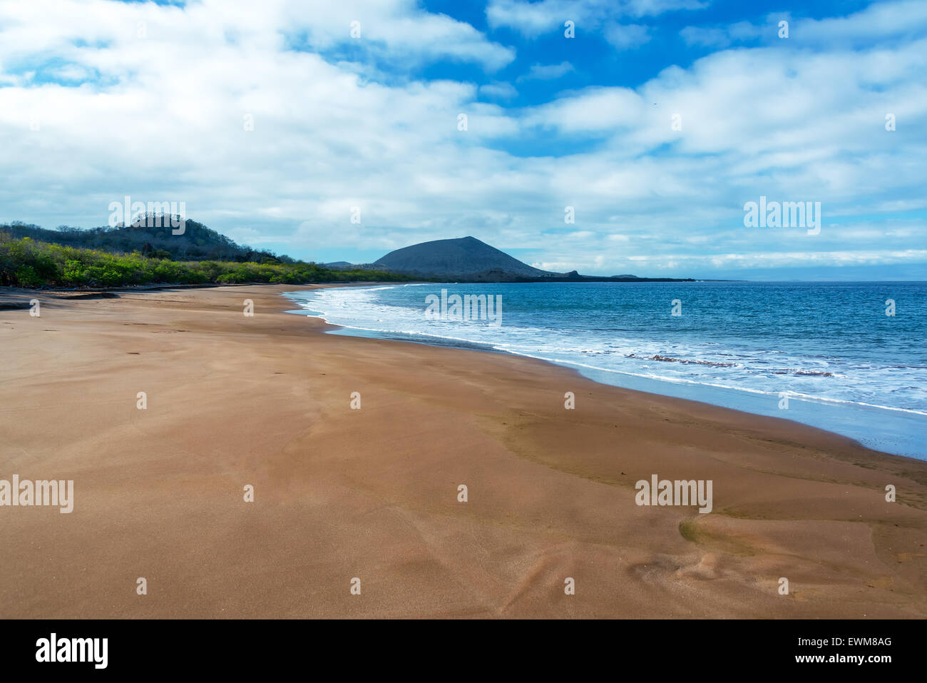 Wide sandy beach on Santiago Island in the Galapagos Islands - Stock Image