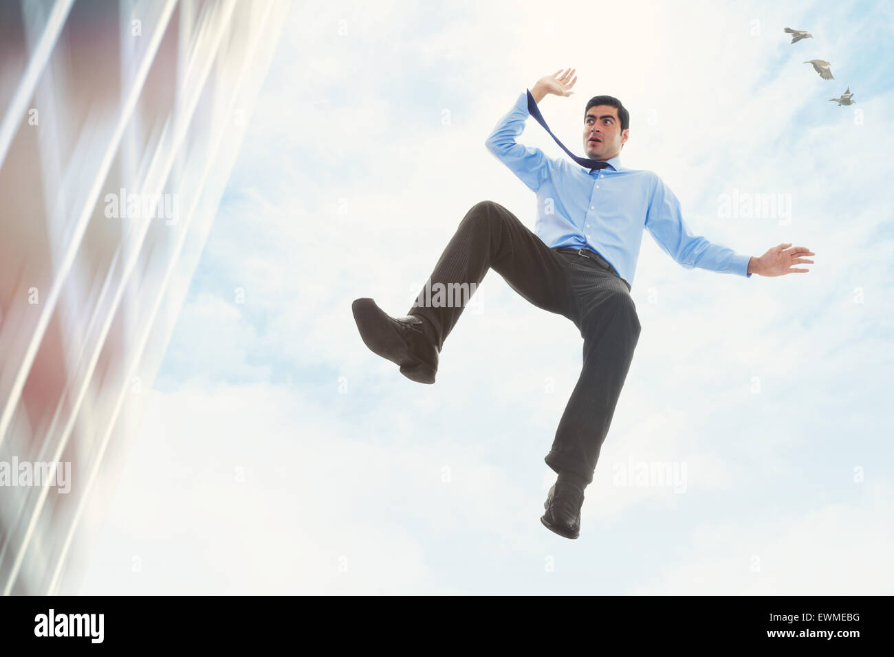 Stock Image Of Businessman Falling Off A Building