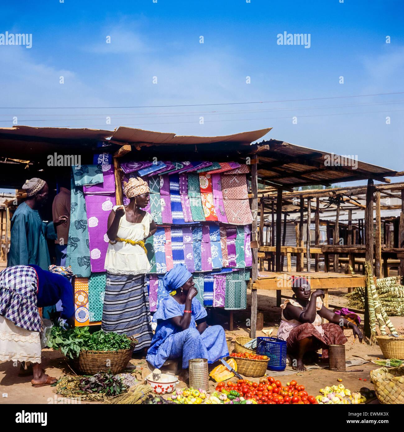 Vegetable and household linen merchants, Albert market, Banjul, Gambia, West Africa - Stock Image