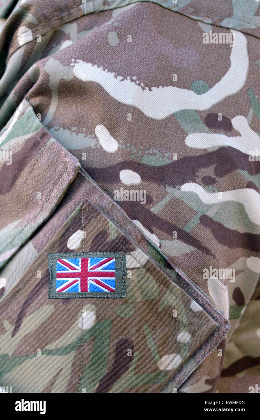 British Army soldier camouflage uniform with the national British Flag  Badge on It. background texture - Stock Image