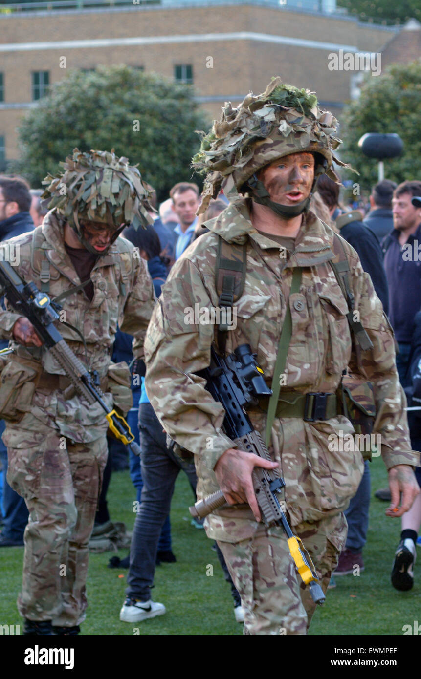 LONDON - MAY 14 2015:British Army soldiers.According to Ministry of Defence, it costs £30,000 to train a soldier. - Stock Image