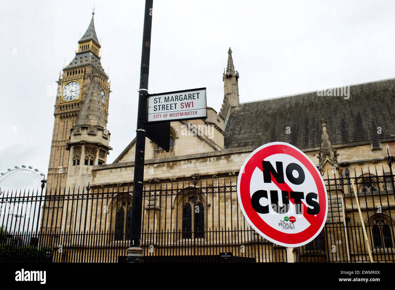 March against austerity,  A sign saying 'No cuts' is placed in front of Big Ben and the Houses of Parliament. - Stock Image
