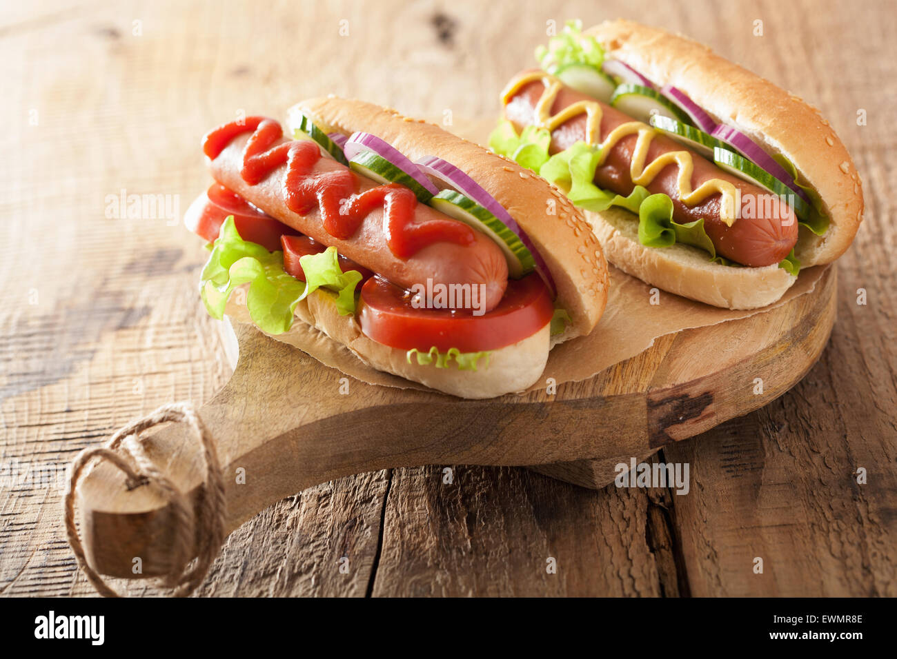 hotdog with ketchup mustard and vegetables - Stock Image