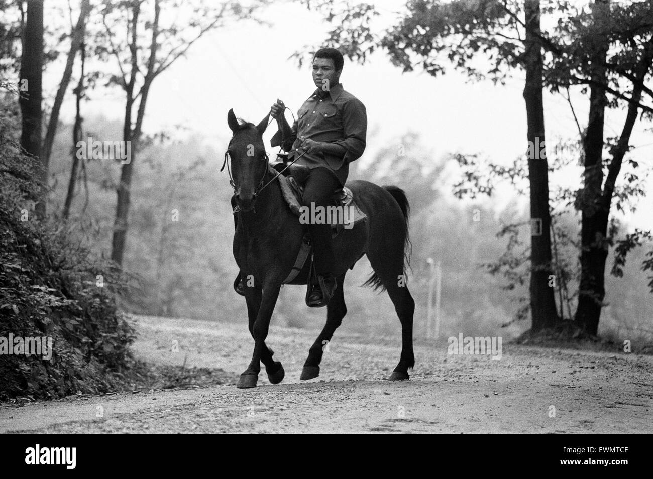 Muhammad Ali riding a horse in Deer Lake Pennsylvania. 5th July 1973 - Stock Image