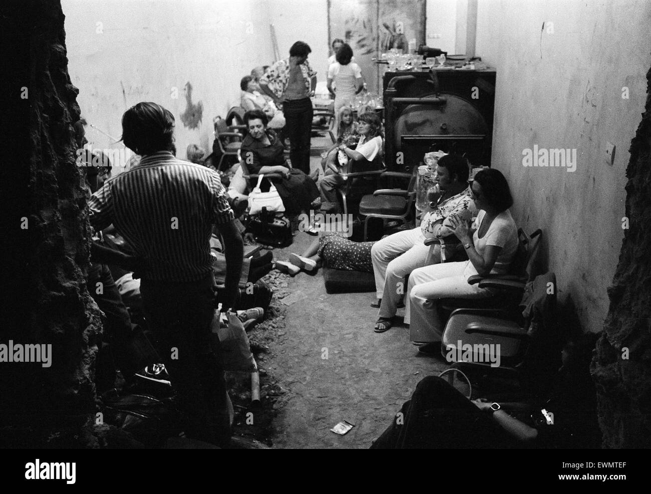 The Turkish invasion of Cyprus. Guests crowd together in the basement area of the Ledra Palace Hotel. The Ledra - Stock Image