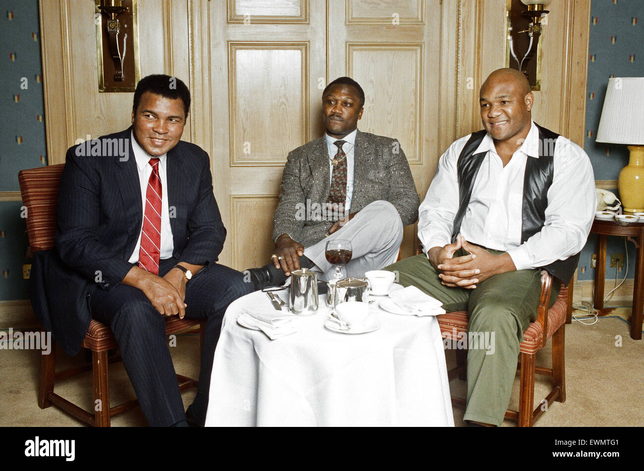 Hall of fame boxers (from left to right) Joe Frazier George Foreman and Muhammad Ali In the video Champions Forever - Stock Image