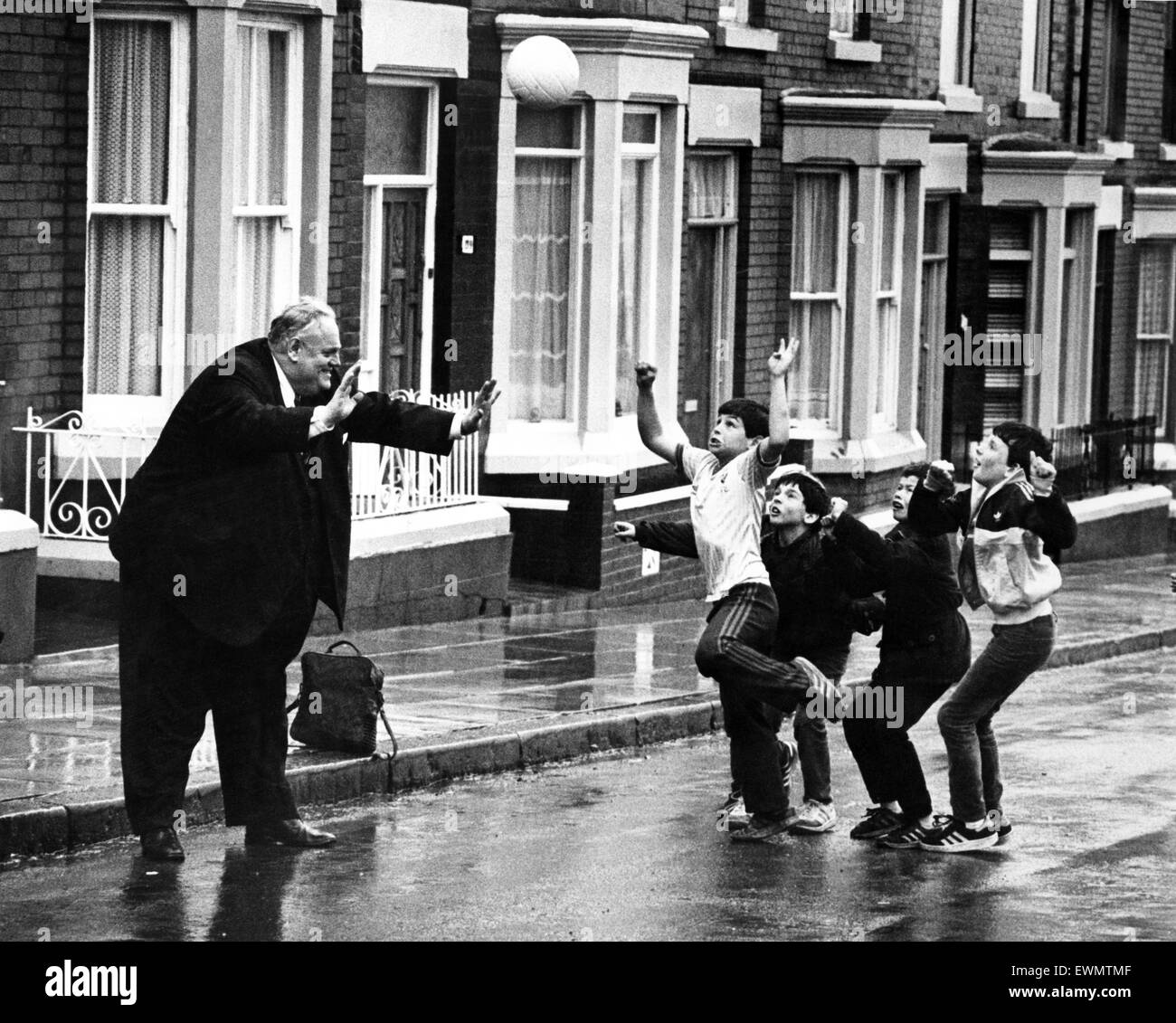 Cyril Smith, Liberal Member of Parliament for Rochdale playing football with a group of young boys in a street. - Stock Image