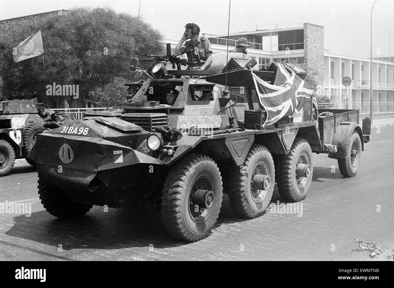The Turkish invasion of Cyprus. A British armoured car, draped with the Union Jack, helps to guard a refugee convoy - Stock Image