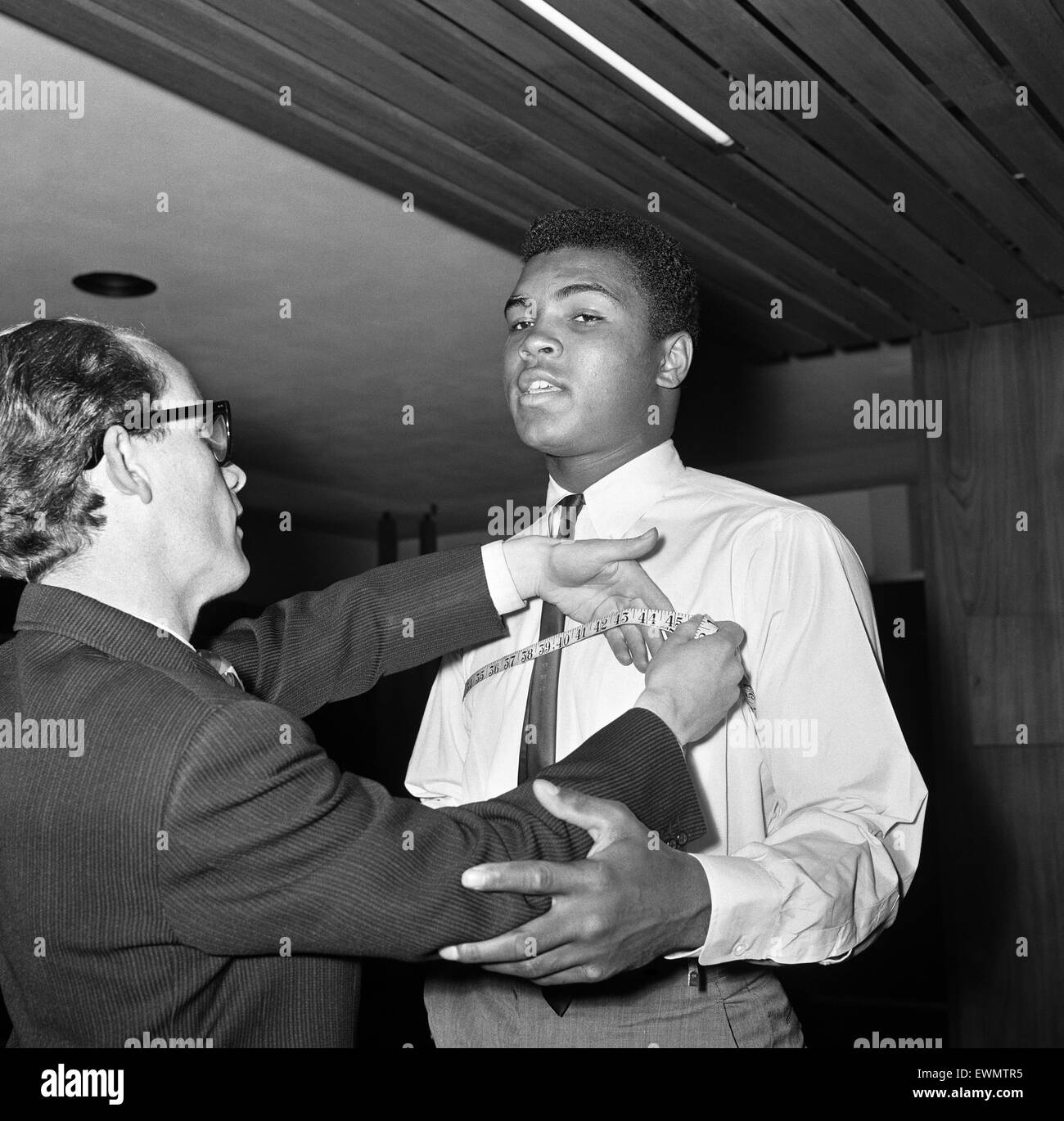 Cassius Clay aka (Muhammad Ali) getting measured at Austin Reeds in London's Regent Street. Cassius was looking - Stock Image