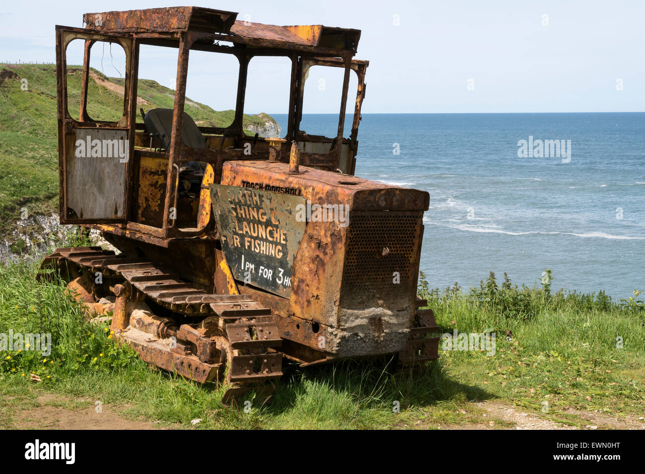 Old and rusting tractor at Flamborough North Landing, Yorkshire. Once it would have worked  pulling boats onto the - Stock Image