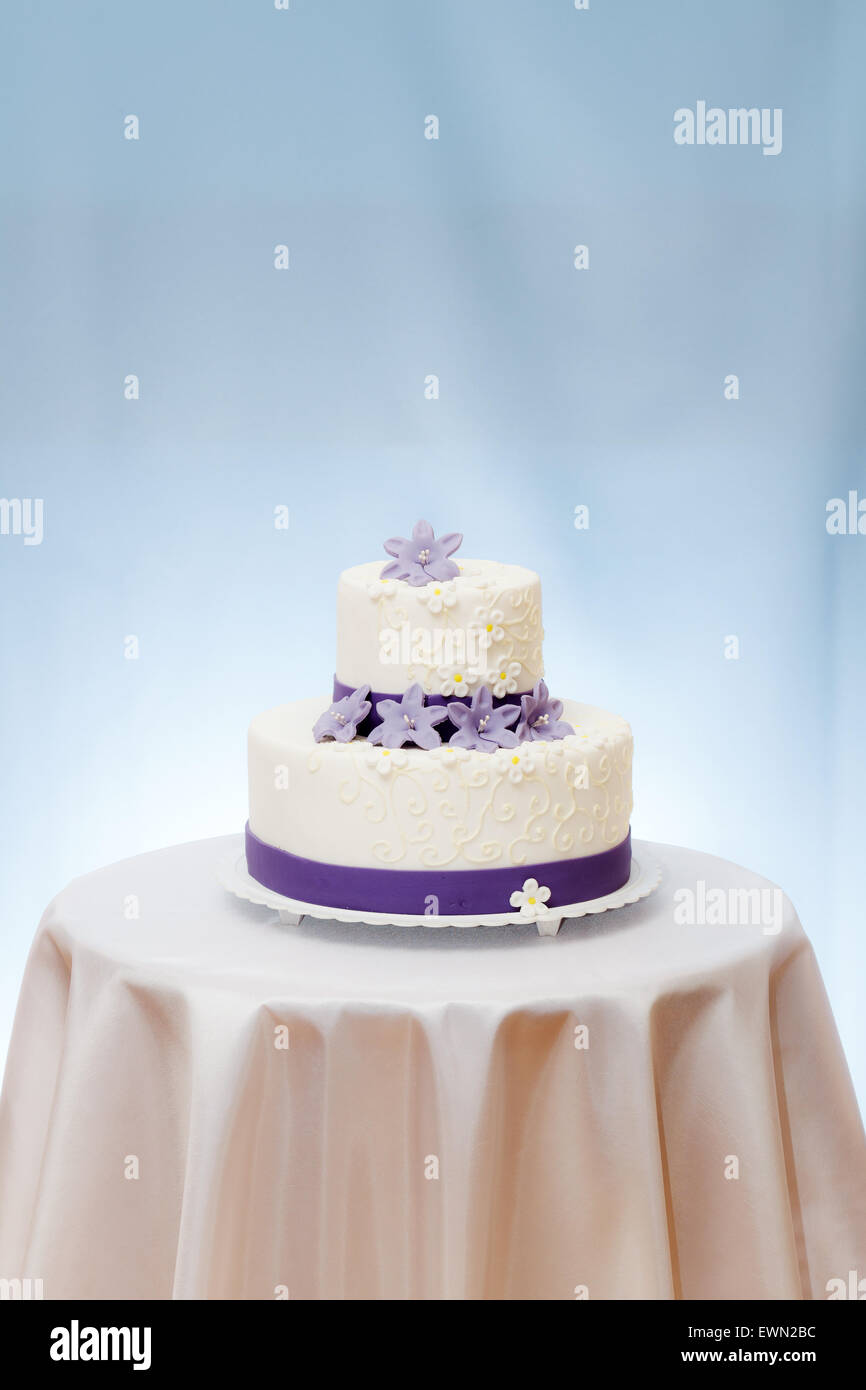 Wedding Cake With Violet Flower Decoration On Table Copy Space Above Stock Photo Alamy