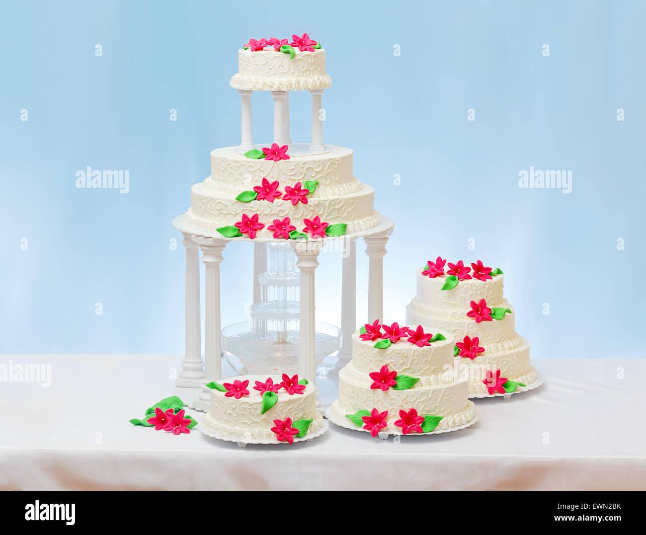 Multi Storey White Wedding Cakes With Pink Flower Decoration Stock