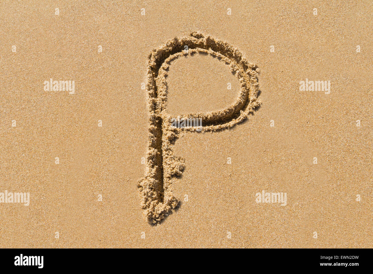 Letter P of the alphabet written on sand with upper case. - Stock Image