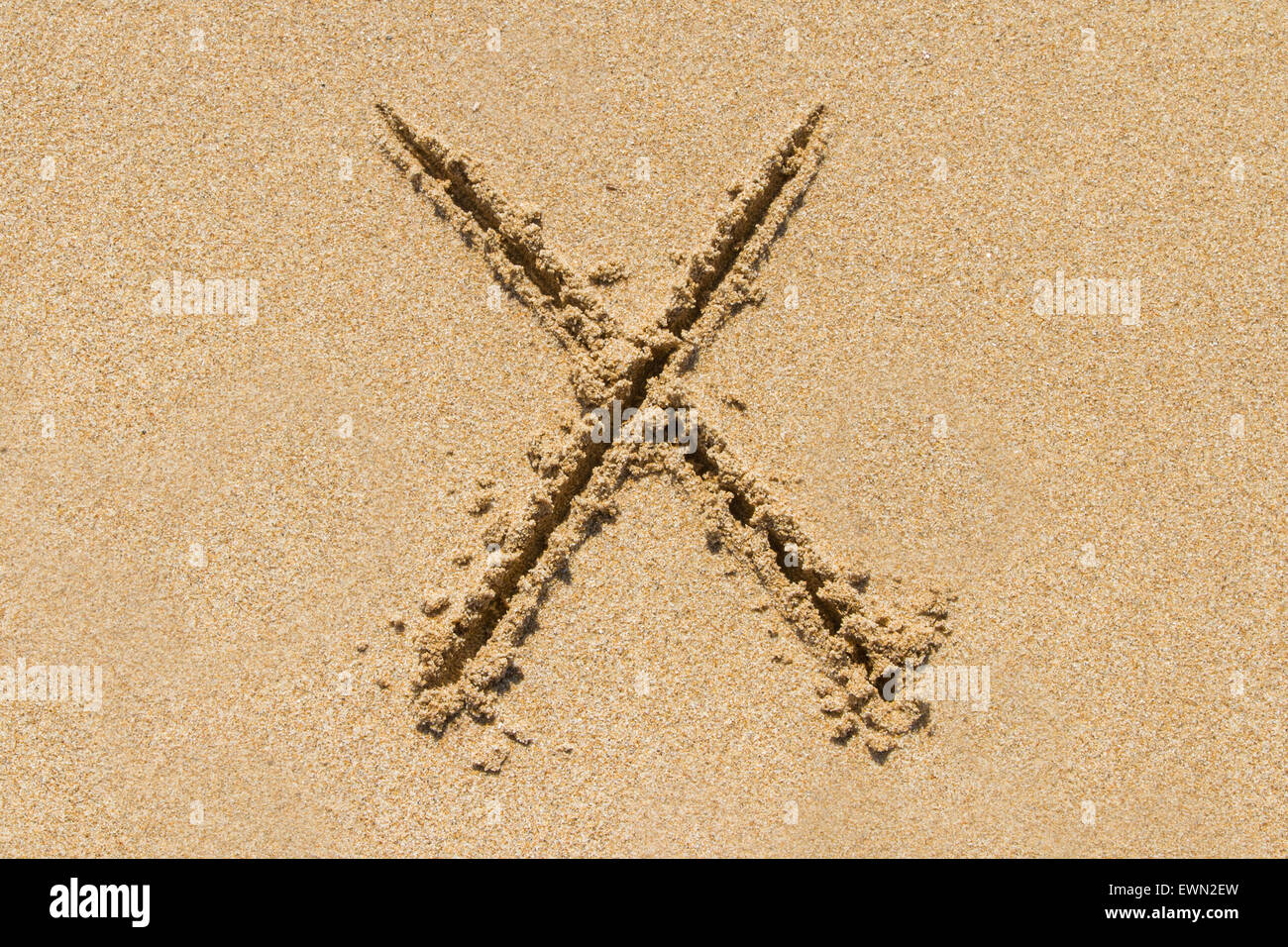 Letter X of the alphabet written on sand with upper case. - Stock Image