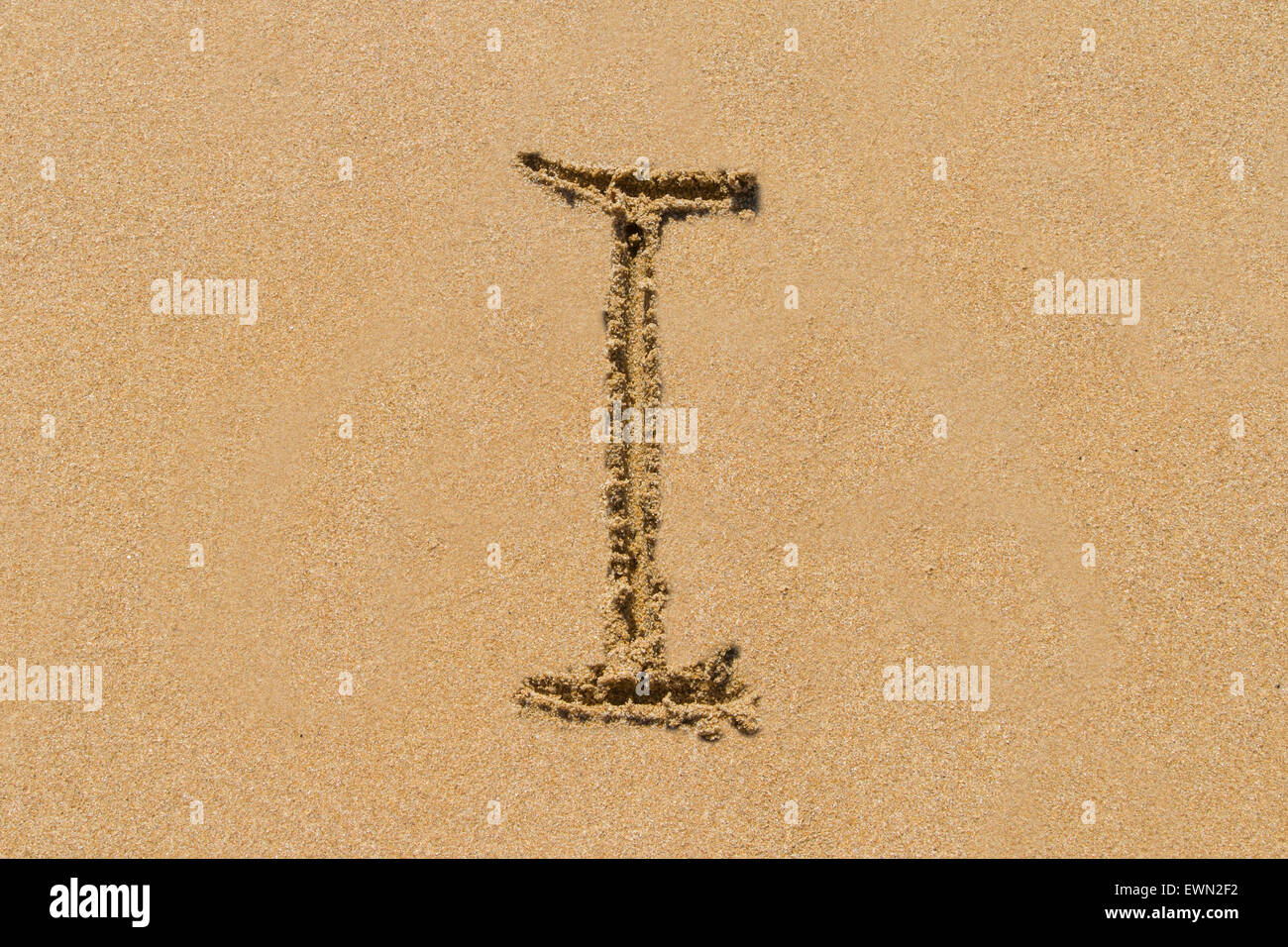 Letter I of the alphabet written on sand with upper case. - Stock Image
