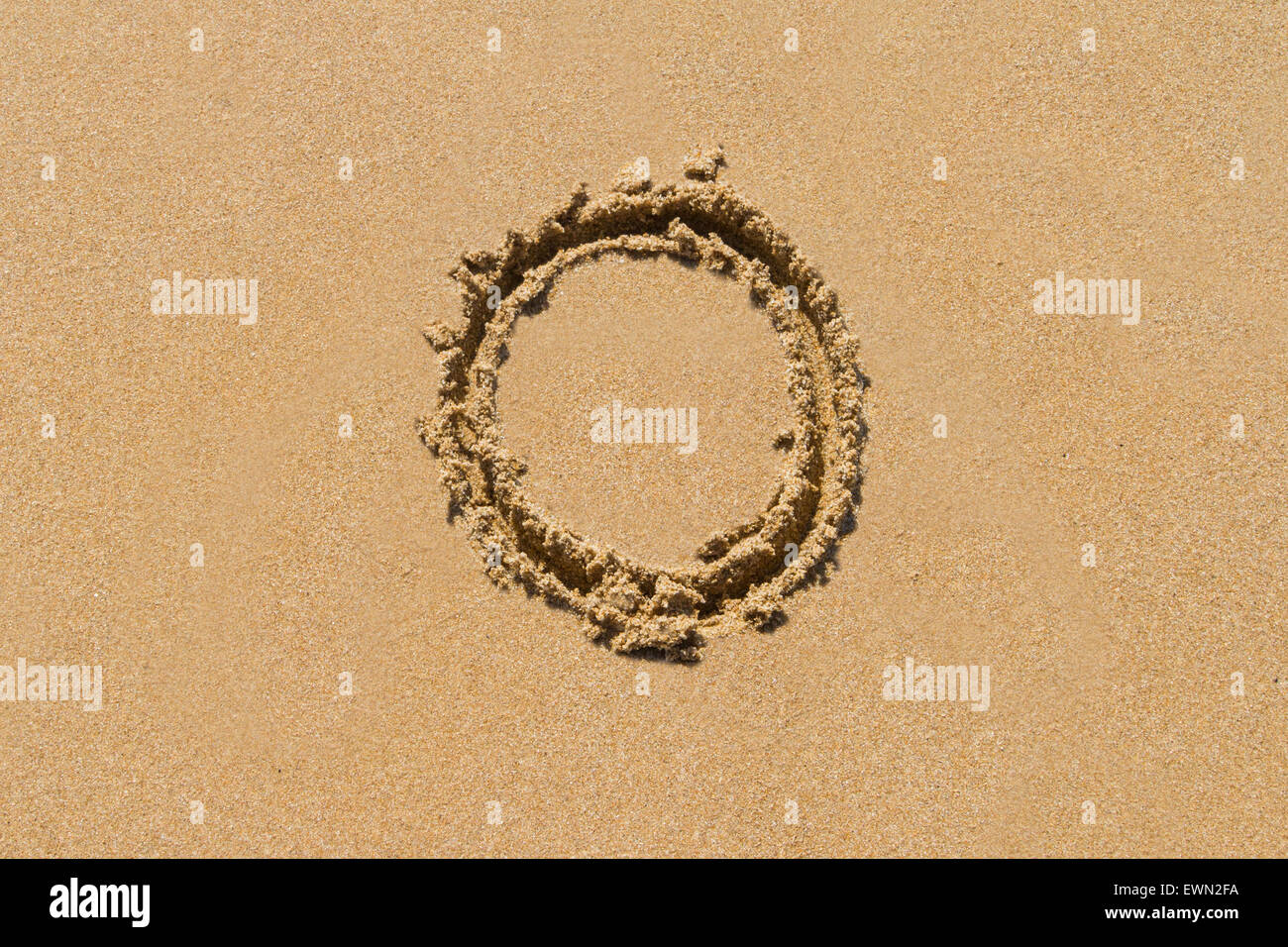 Letter O of the alphabet written on sand with upper case. - Stock Image