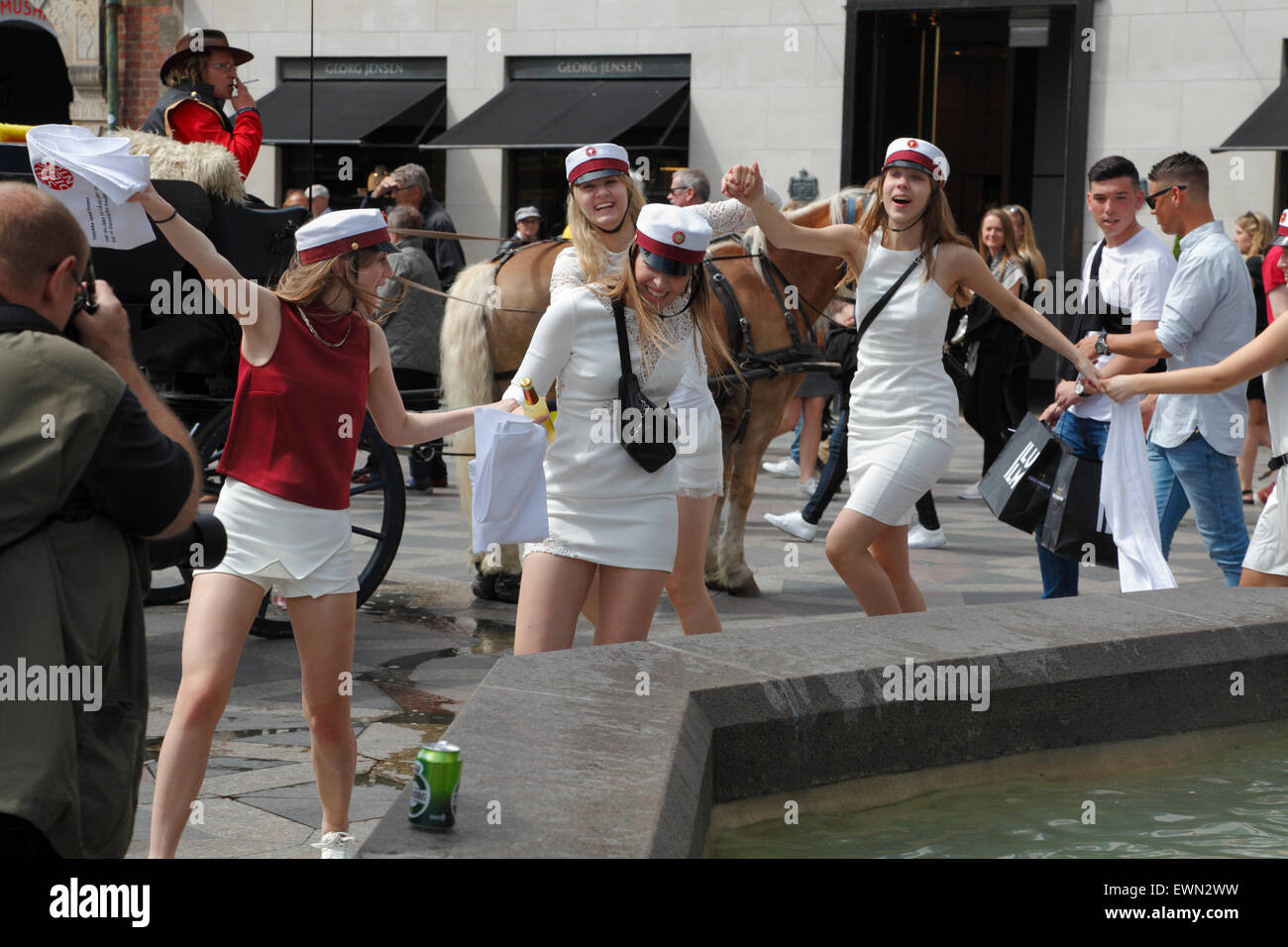 Danish high school students celebrate their graduation by the traditional dance round the Stork Fountain, Stroeget, - Stock Image