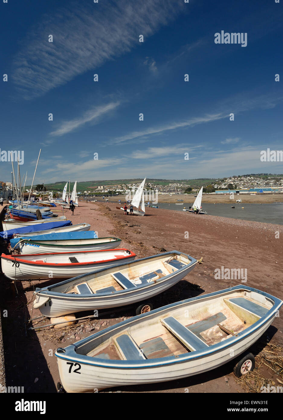 Boats on Shaldon beach, looking towards Teignmouth. Stock Photo
