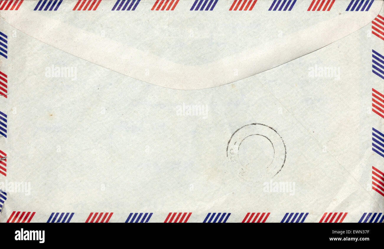 Old closed air mail envelope with stamp - Stock Image