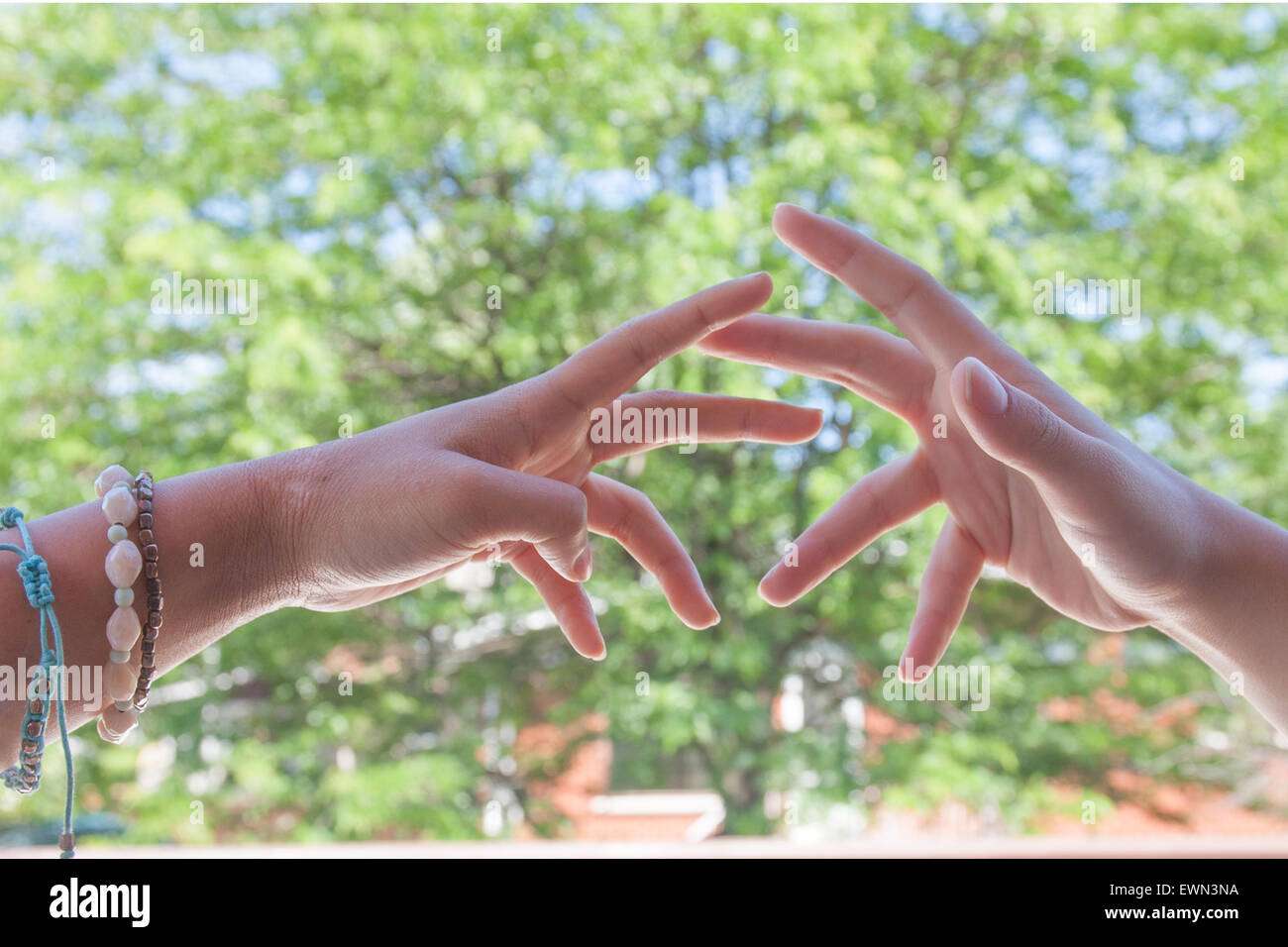 Youthful hands up demonstrating emotion, statements of togetherness. - Stock Image