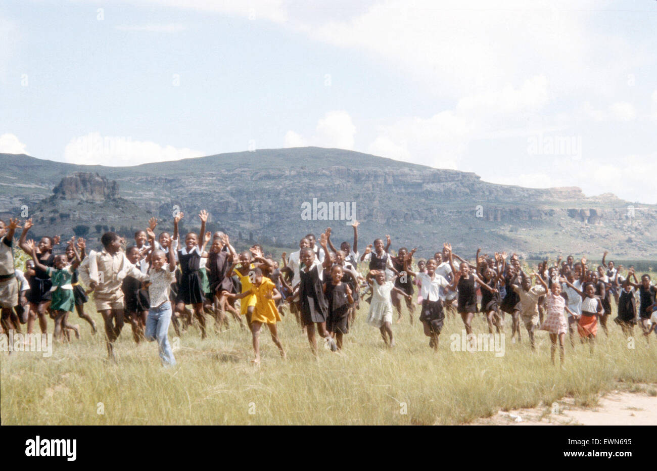 LESOTHO SCHOOL CHILDREN RUNNING - Stock Image