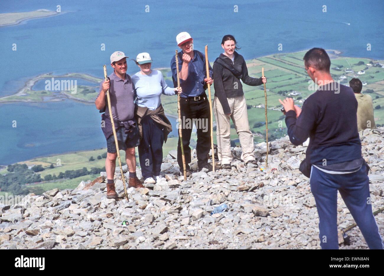 CROGH PATRICK CO MAYO IRELAND, PILGRIMS POSE ON REEK SUNDAY - Stock Image
