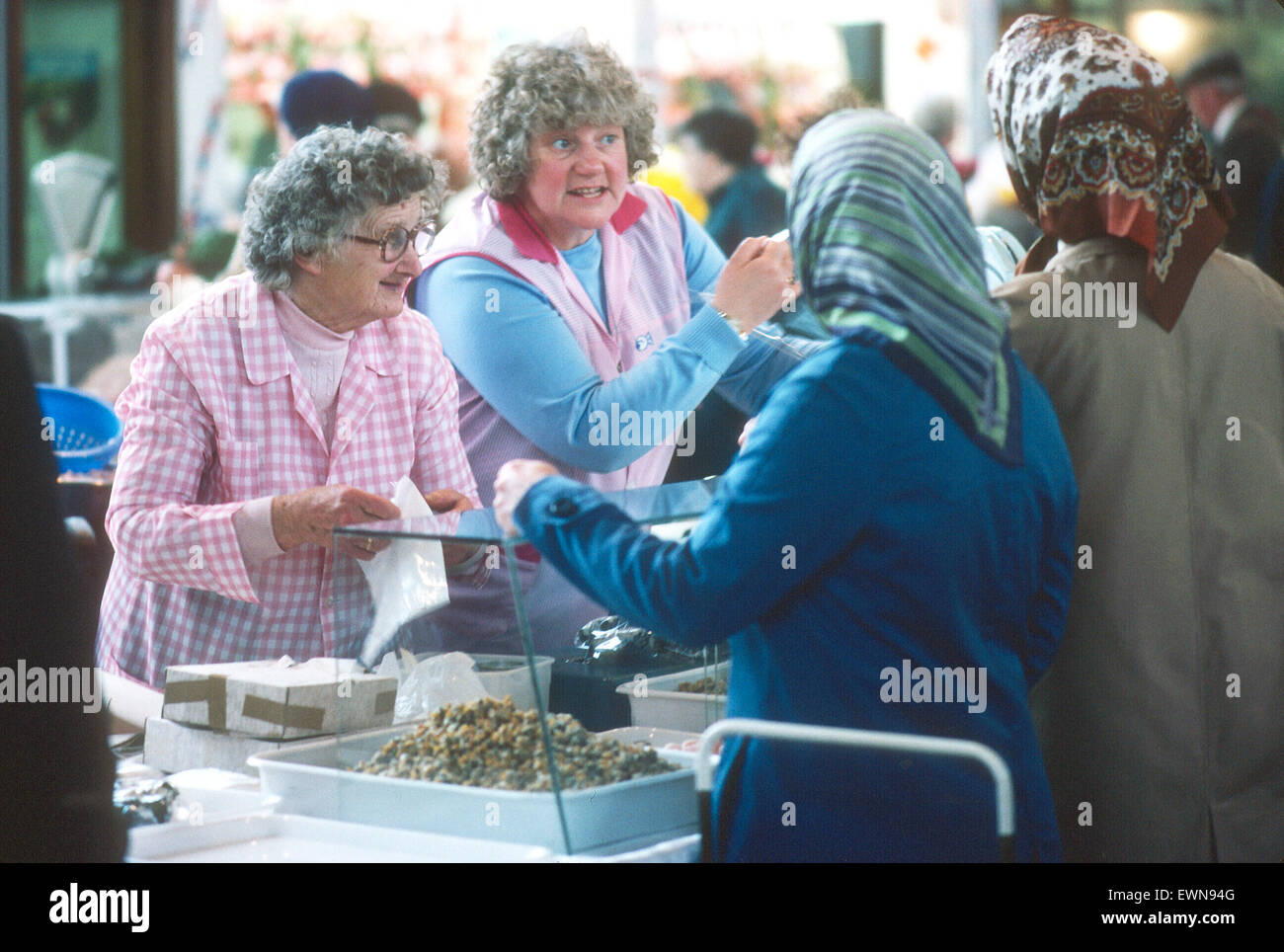 WOMEN CHAT AS THEY SELL COCKLES IN SWANSE UK - Stock Image