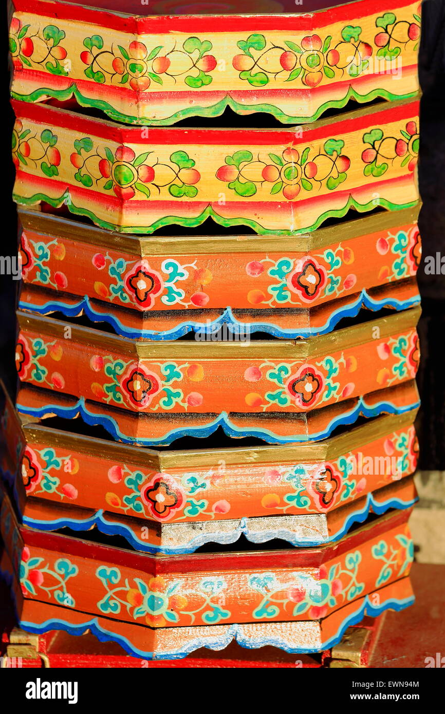 Traditional tibetan style wooden trays stacked on the street at the entry to a local carpenter.s workshop. Gyantse - Stock Image