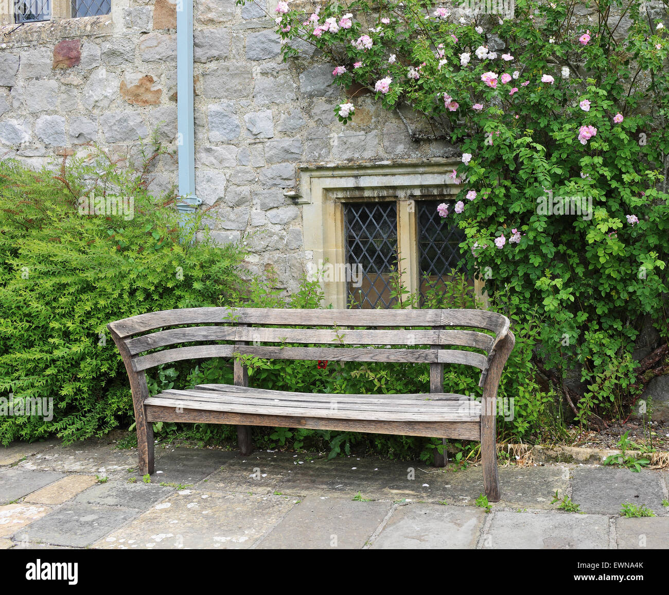 Stupendous Bench Seat In An English Medieval Garden With Roses Climbing Machost Co Dining Chair Design Ideas Machostcouk