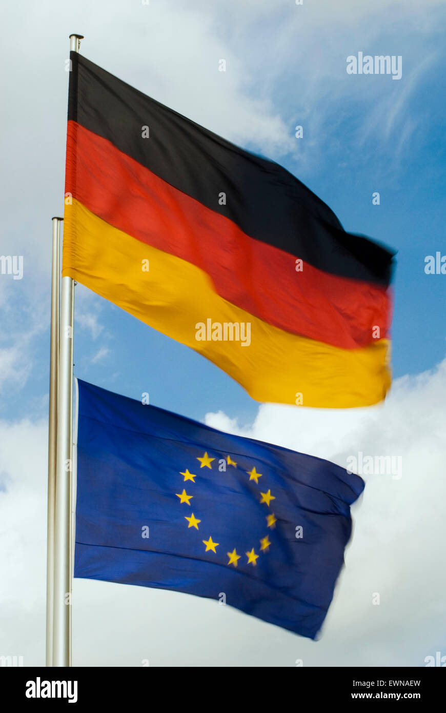 German and european union flags stream in the wind berlin germany - Stock Image