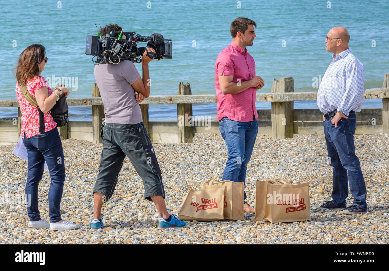Gregg Wallace and Chris Bavin filming for the Eat Well for less TV show on a beach in Littlehampton, West Sussex, - Stock Image