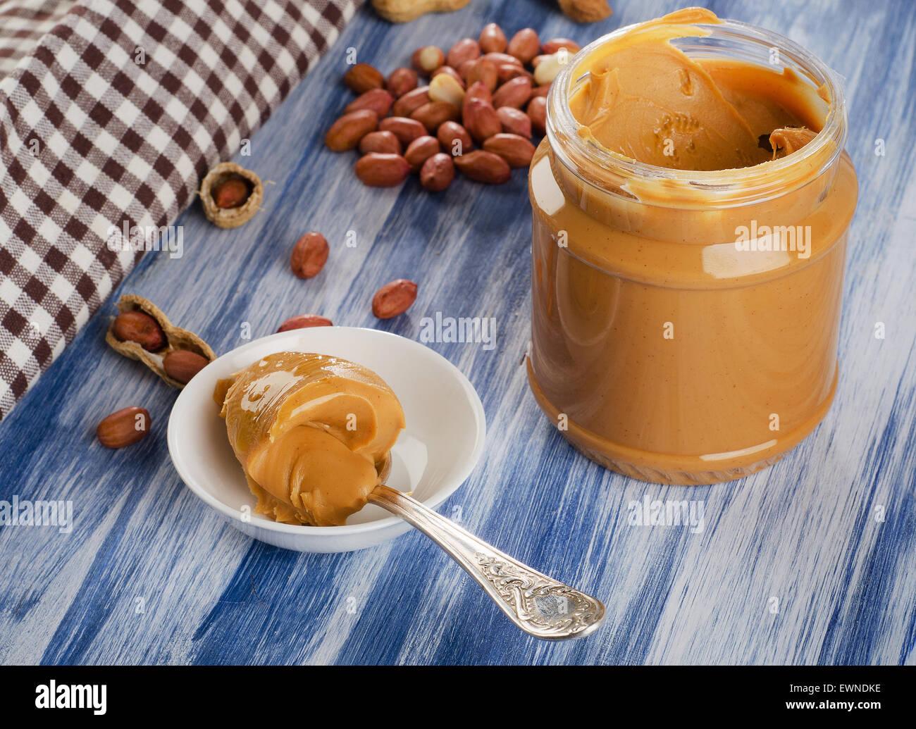Peanut butter in  spoon  with peanuts.  Shallow dof. - Stock Image