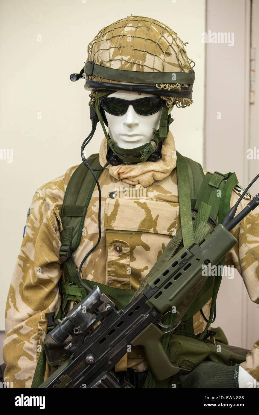 A British Army soldiers uniform in a museum at Balallan on the Isle of Lewis, Outer Hebrides, Scotland, UK. - Stock Image