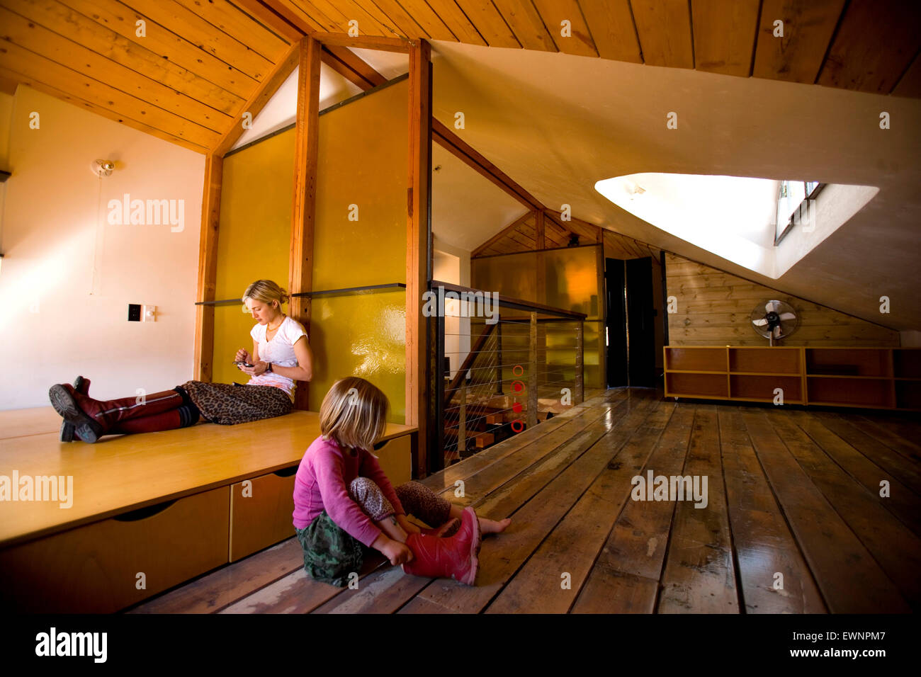 Mother and daughter in remodeled home that used 95% reclaimed material for the redesign Stock Photo