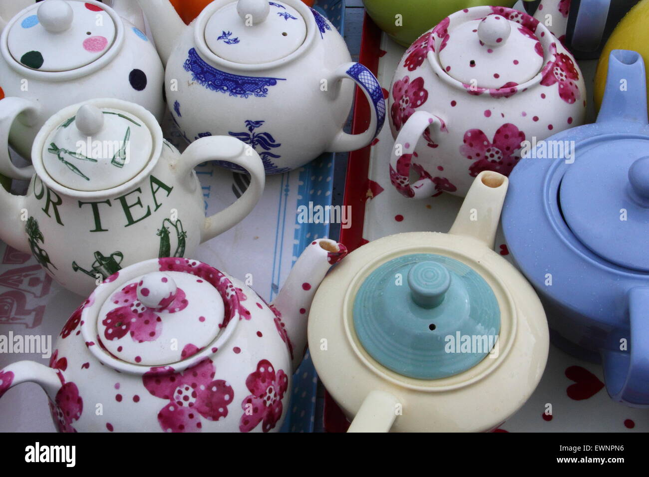 Vintage teapots in a stylish pop up tearoom at a traditional English summer  festival, England,UK - Stock Image