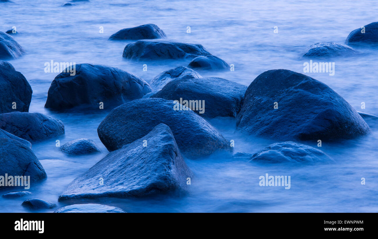 stones in water at blue hour near lohme on rugen, mecklenburg-vorpommern, germany - Stock Image