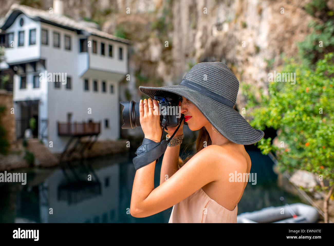 Woman photographing in Blagaj village - Stock Image