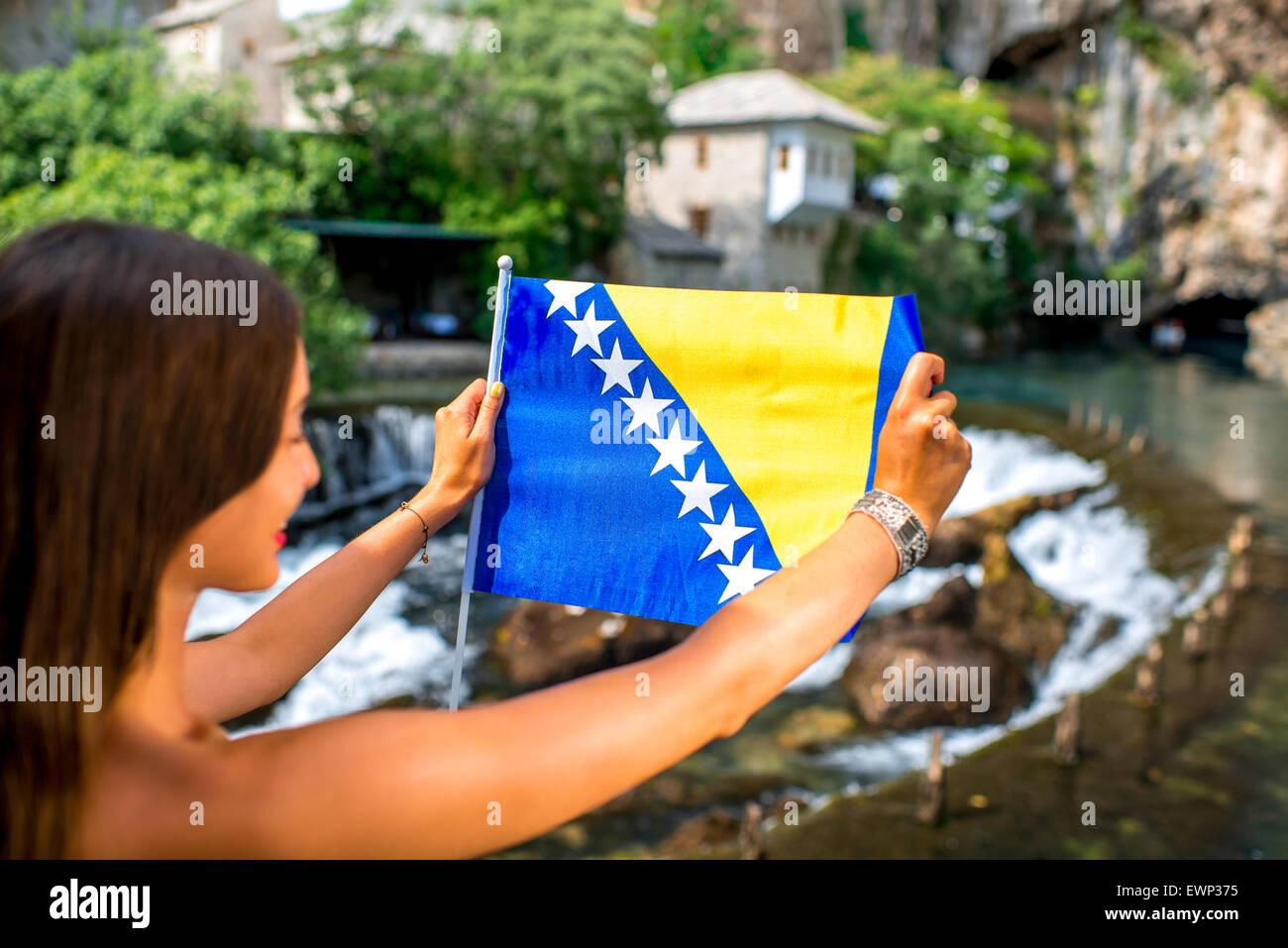 Woman with Bosnian flag in Blagaj village - Stock Image