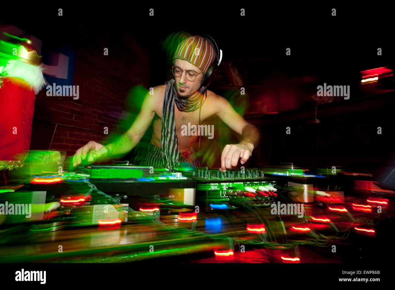 A DJ doing his thing. - Stock Image