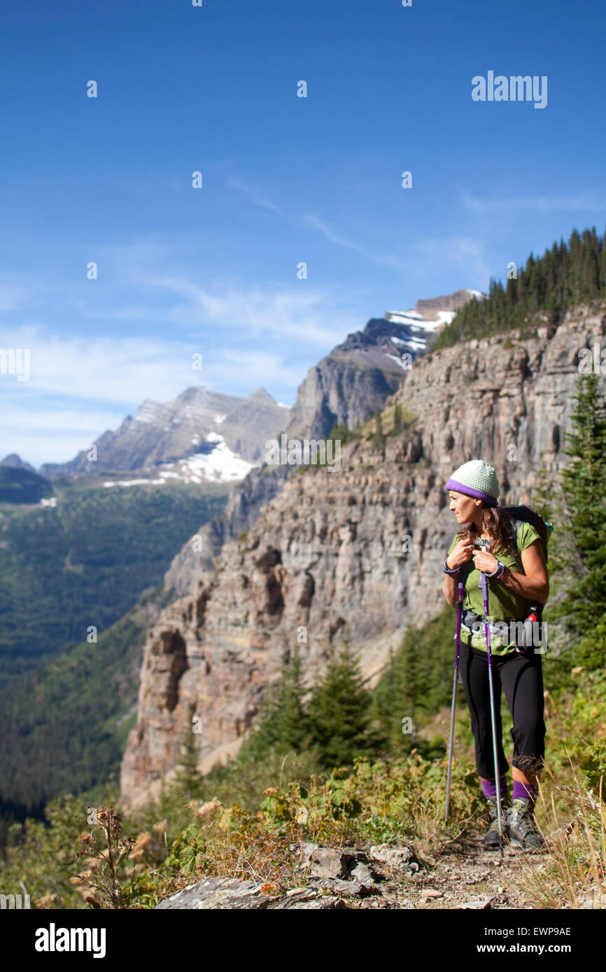 A woman hiking in the high country. - Stock Image
