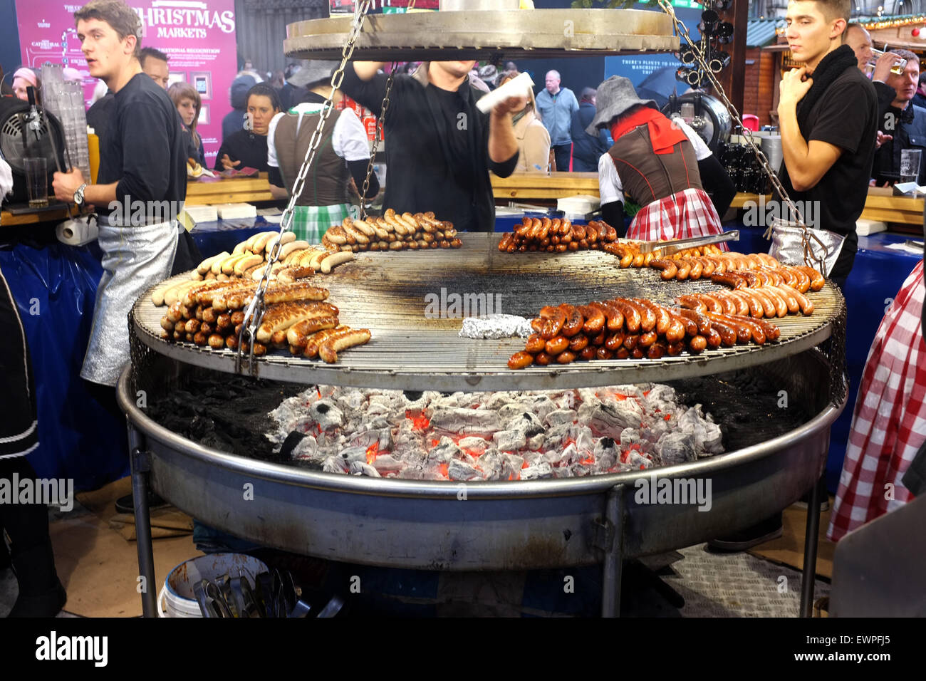 German Barbecue sausage stall at the Christmas Market in Albert Square, Manchester, England UK - Stock Image