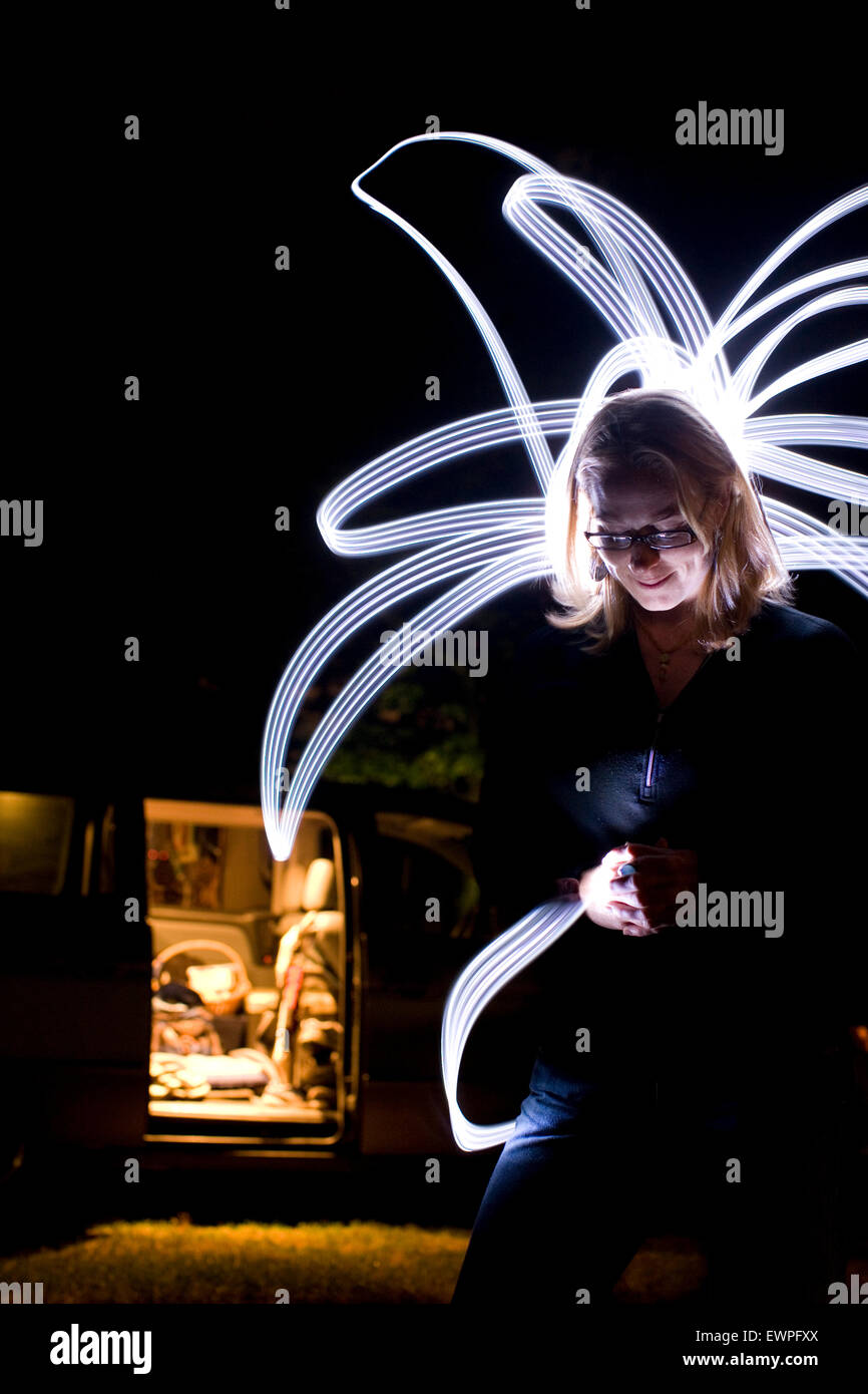 Portrait of woman with light writing. - Stock Image