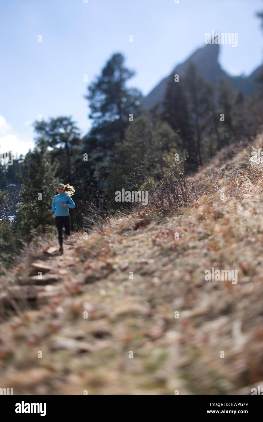 Woman Trail Runner Running Toward Camera